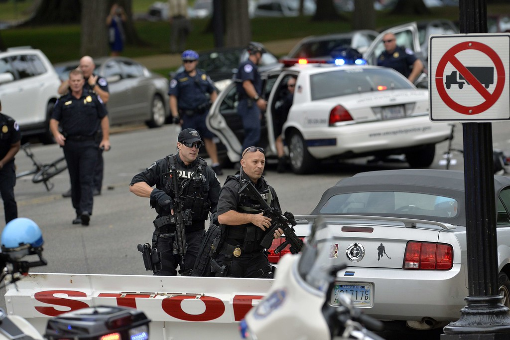 """. Police run after shots fired were reported near 2nd Street NW and Constitution Avenue on Capitol Hill in Washington, DC, on October 3, 2013.  The US Capitol was placed on security lockdown Thursday after shots were fired outside the complex, senators said. \""""Shots fired outside the Capitol. We are in temporary lock down,\"""" Senator Claire McCaskill said on Twitter. Police were seen running within the Capitol building and outside as vehicles swarmed to the scene. AFP Photo/Jewel SAMAD/AFP/Getty Images"""