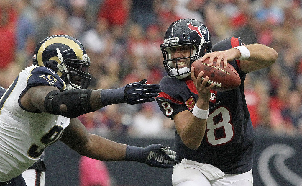 . Houston Texans quarterback Matt Schaub (8) tries to avoid a tackle by St. Louis Rams defensive tackle Michael Brockers during an NFL football game   Sunday, Oct. 13, 2013, in Houston. St. Louis defeated Houston 38-13. (AP Photo/ The Courier, Jason Fochtman)