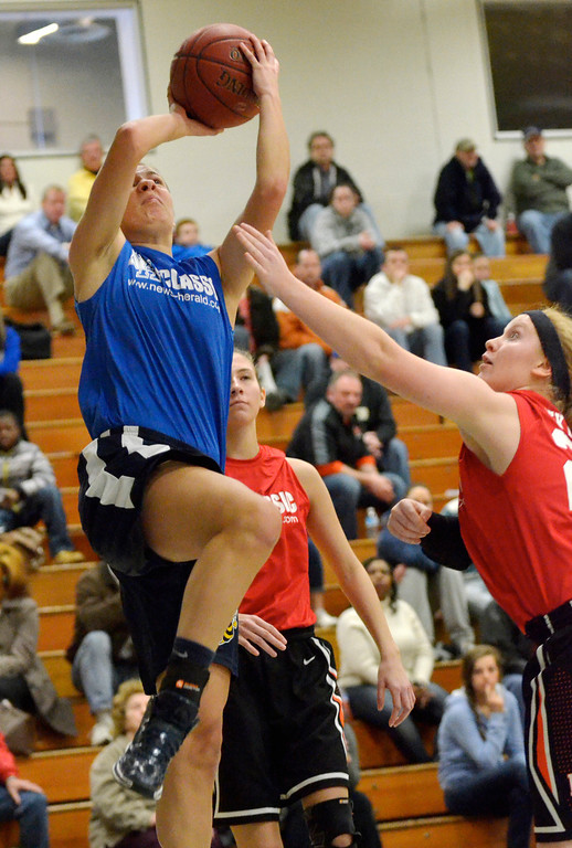 . Jeff Forman/JForman@News-Herald.com Karen Somes, of the Blue Team, shoots as Halle McKinley defends during the 36th News-Herald Classic March 29 at Lakeland Community College.