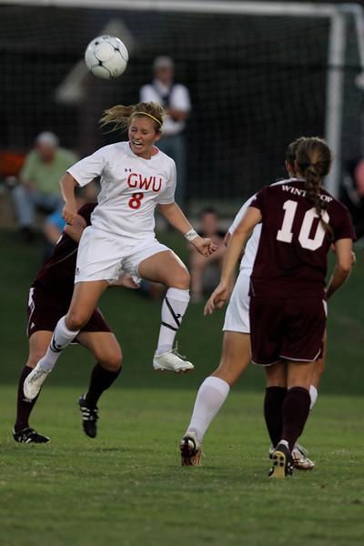 Megan Curan (8) heads the ball.