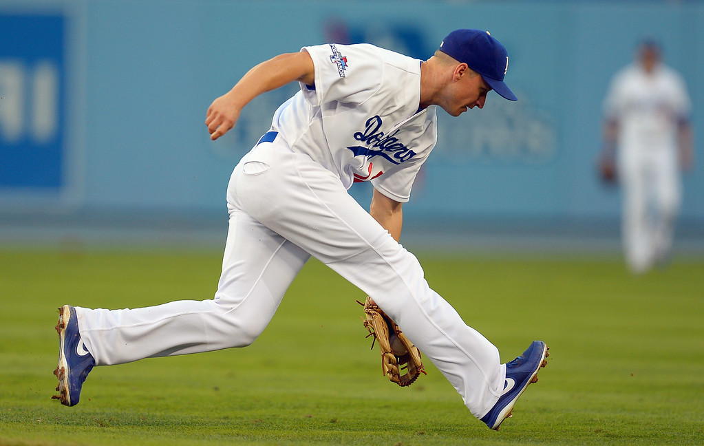 . The Dodgers\' Mark Ellis fields a ground ball against the Cardinals during game 4 of the NLCS at Dodger Stadium Tuesday, October 15, 2013. (Photo by Andy Holzman/Los Angeles Daily News)