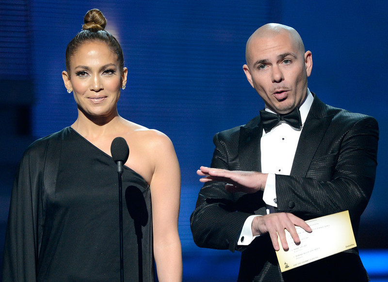 . Singers Jennifer Lopez and Pitbull speak onstage at the 55th Annual GRAMMY Awards at Staples Center on February 10, 2013 in Los Angeles, California.  (Photo by Kevork Djansezian/Getty Images)