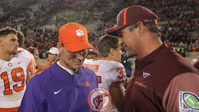Defensive coordinator Bud Foster speaks with his Clemson counterpart Brent Venables after the game. (Mark Umansky/TheKeyPlay.com)