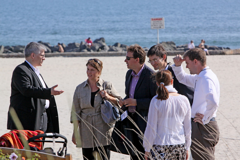 Uwe Feuersenger (L), Partner and CEO of aeris CAPITAL AG, lands on the beach with Matthias Hohensee, Senior U.S. Correspondent for Wirtschaftschwoche; Georg Kopetz, Executive Board Member of FiReStarter company TTTech Computertechnik AG; Niall Davis, Partner, aeris CAPITAL AG; and guests