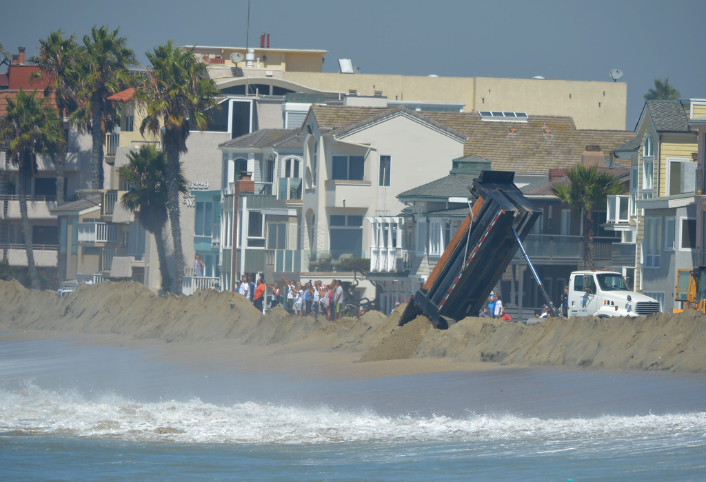 . High tide and a storm surge from Hurricane Marie had locals bracing for the worst in the Peninsula neighborhood in Long Beach, CA on Wednesday, August 27, 2014. With city crews constantly building a sand berm, the water was held back from the homes and streets during the morning high tide. (Photo by Scott Varley, Daily Breeze)