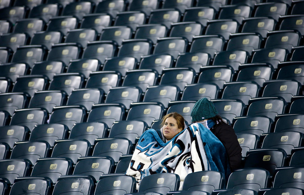 . Philadelphia Eagles fans sit in the stands after the Eagles lost an NFL wild-card playoff football game against the New Orleans Saints, 26-24, Saturday, Jan. 4, 2014, in Philadelphia. (AP Photo/Matt Rourke)