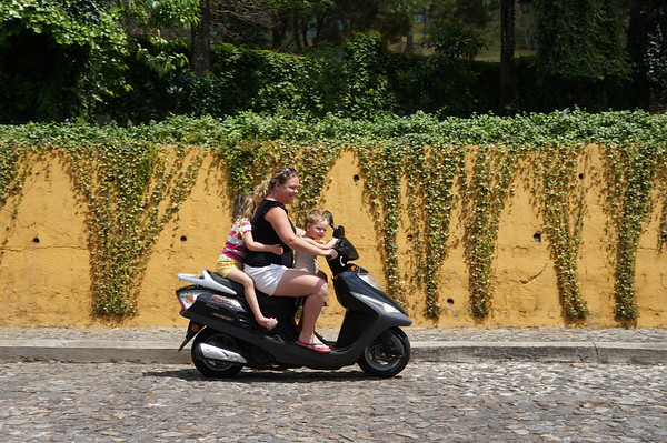 Riding a scooter as a family