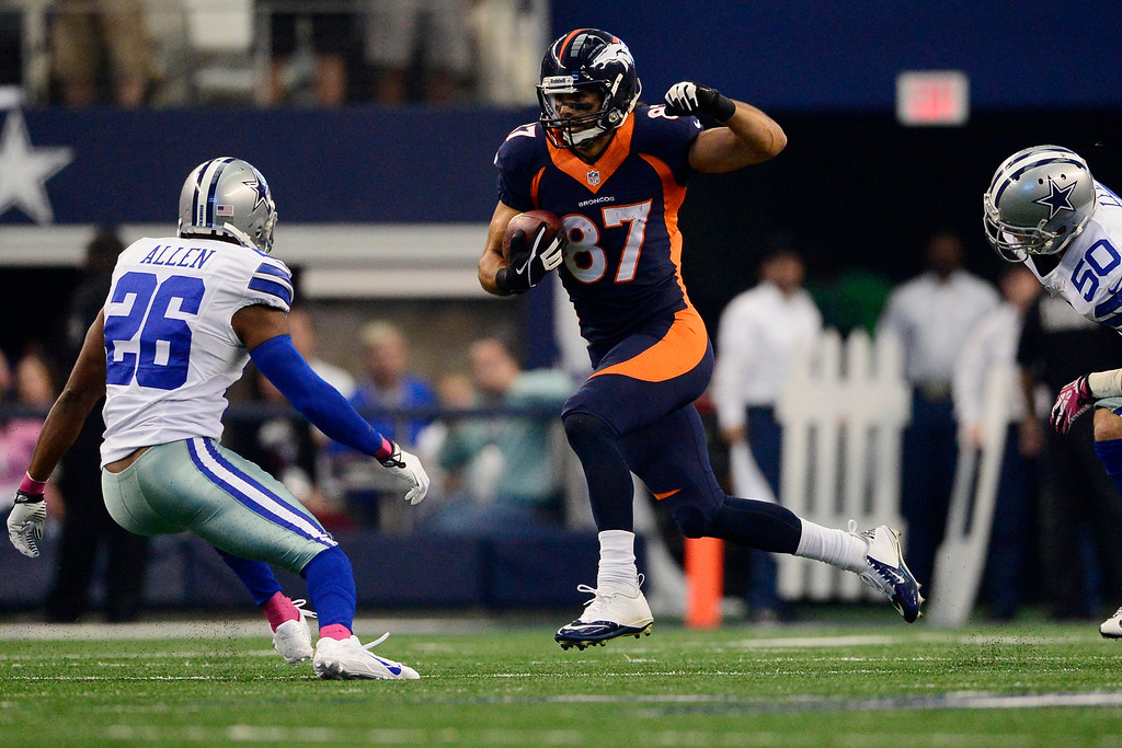 . Eric Decker (87) of the Denver Broncos makes a move on Will Allen (26) of the Dallas Cowboys before fumbling the ball during the first half of action at AT&T Stadium.   (Photo by AAron Ontiveroz/The Denver Post)
