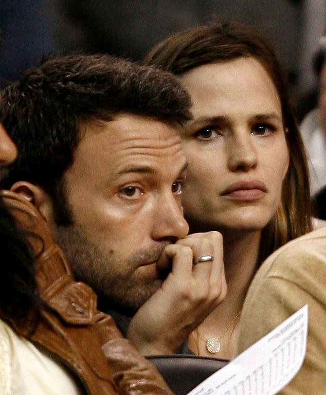 . Actor Ben Affleck and his wife, actress Jennifer Garner, watch during the fourth quarter of the Boston Celtics\' 101-82 loss to the Orlando Magic in Game 7 of an NBA Eastern Conference semifinal basketball series in Boston on Sunday, May 17, 2009. (AP Photo/Winslow Townson)