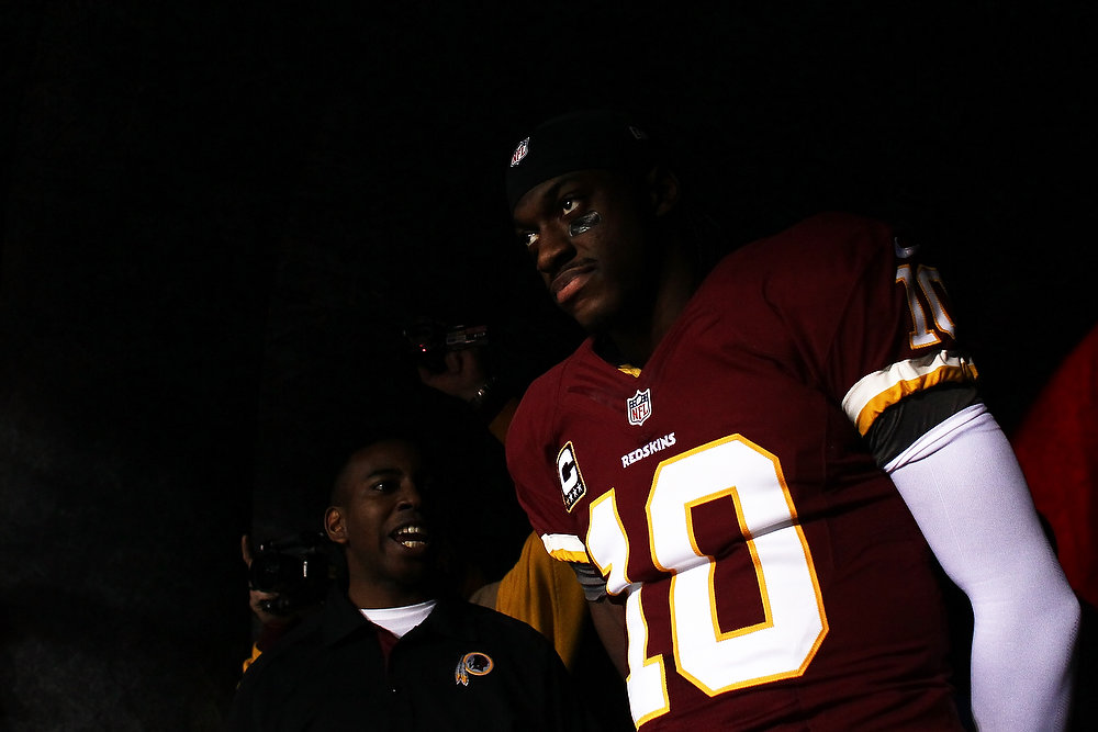 Description of . Robert Griffin III #10 of the Washington Redskins walks through the tunnel prior to their NFC Wild Card Playoff Game against the Seattle Seahawks at FedExField on January 6, 2013 in Landover, Maryland.  (Photo by Win McNamee/Getty Images)