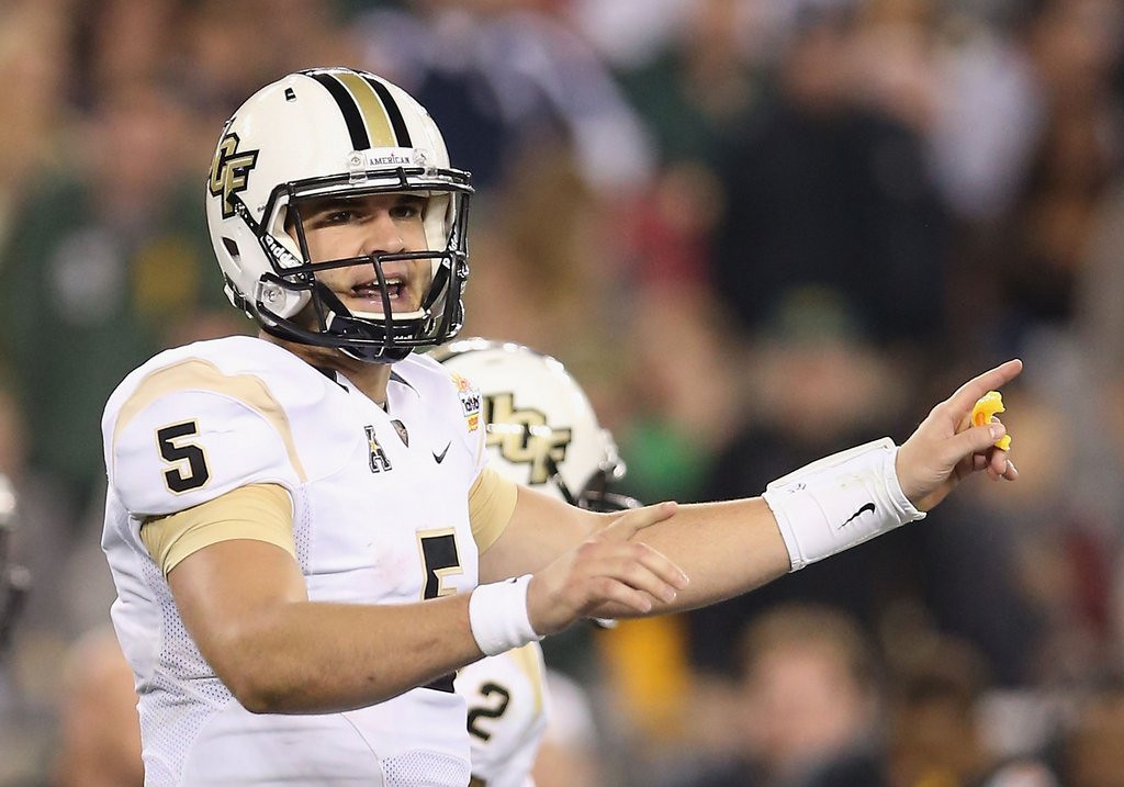 """. <p><b> Top quarterback prospect Blake Bortles got some bad news this week when one coach unfavorably compared him to this passer � </b> <p> A. Blaine Gabbert <p> B. Tim Tebow <p> C. Garo Yepremian <p><b><a href=\'http://q.usatoday.com/2014/03/31/nfl-coach-compares-blake-bortles-to-blaine-gabbert/\' target=\""""_blank\"""">HUH?</a></b> <p>   (Christian Petersen/Getty Images)"""