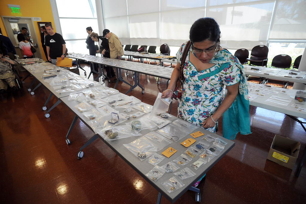 . Nirupma Arora looks over items during a public viewing of recovered stolen property at LAPD\'S Topanga Division in Canoga Park Thursday, September 26, 2013.  (Photo by Hans Gutknecht/Los Angeles Daily News)