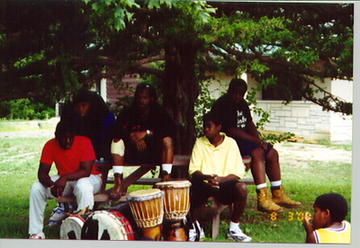 Nation Builders Ayinde West and Horace C. Neal and Simba campers at African drumming lesson.