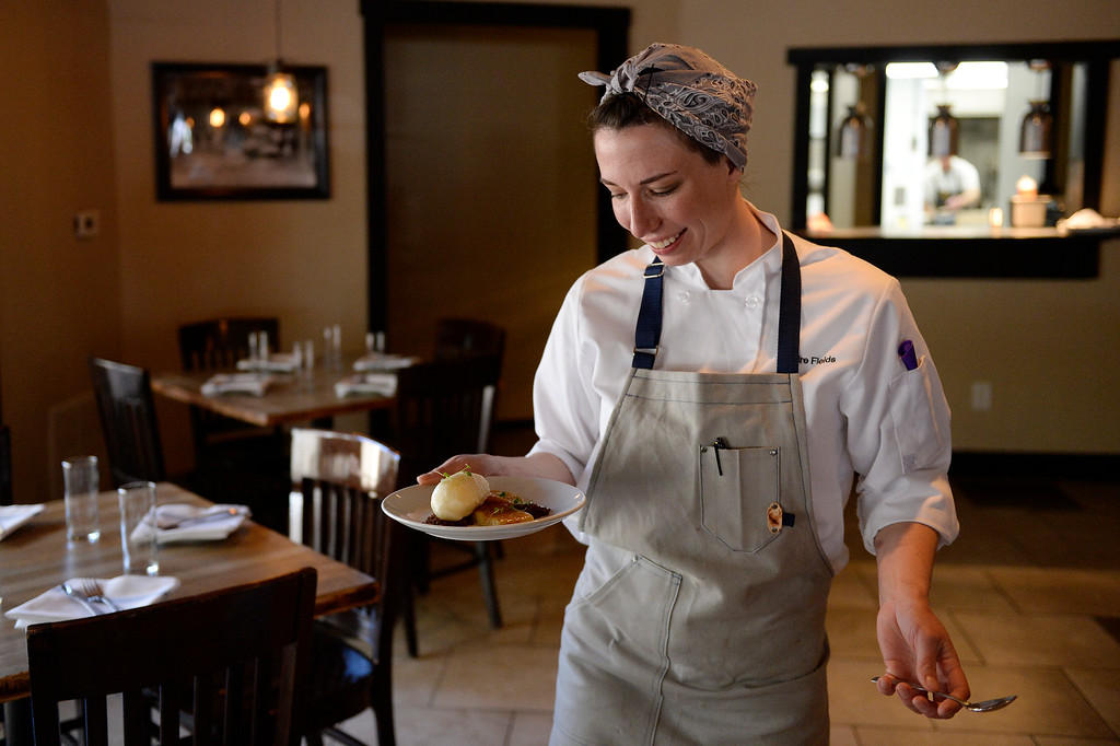 . DENVER, CO - APRIL 21:  Pastry chef Claire Fields carries her Smokejumper Ginger Tea Creme Brûlée with carmelized pineapple, pineapple-brandy sorbet and ginger snap crumble at Grind Kitchen + Watering Hole in Cherry Creek North  in Denver on Thursday, April 21, 2016. (Photo by Cyrus McCrimmon/ The Denver Post)