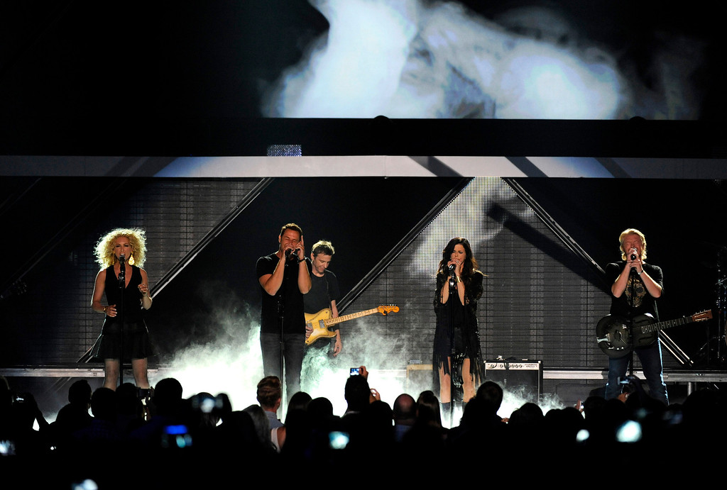 . Members of Little Big Town, from left, Kimberly Schlapman, Jimi Westbrook, Karen Fairchild and Philip Sweet perform at the 2013 CMT Music Awards at Bridgestone Arena on Wednesday, June 5, 2013, in Nashville, Tenn. (Photo by Donn Jones/Invision/AP)