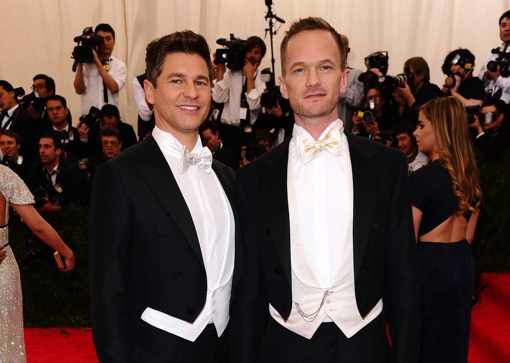 """. Neil Patrick Harris, right, and David Burtka arrive at The Metropolitan Museum of Art\'s Costume Institute benefit gala celebrating \""""China: Through the Looking Glass\"""" on Monday, May 4, 2015, in New York. (Photo by Charles Sykes/Invision/AP)"""