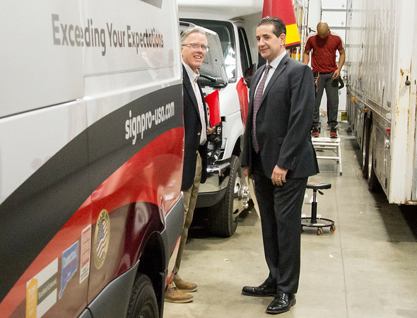 02/10/20 Wesley Bunnell | StaffrrCT State Chief Manufacturing Officer Colin Cooper visited Sign Pro, Inc. in Southington on Monday February 10, 2020. Cooper, L, and Sign Pro President Peter Rappoccio look at vehicles undergoing design installations.