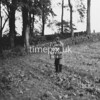 NJ910988A-LongView, Man marking Ordnance Survey minor control revision point with an arrow in 1950s