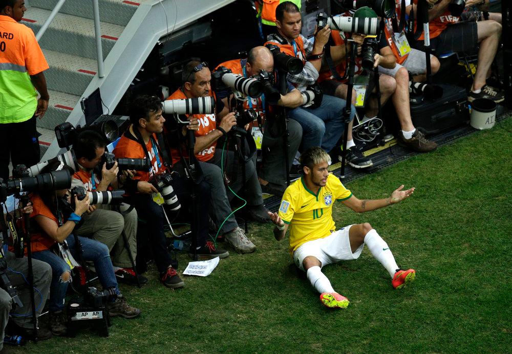 . Brazil\'s Neymar reacts during the group A World Cup soccer match between Cameroon and Brazil at the Estadio Nacional in Brasilia, Brazil, Monday, June 23, 2014. (AP Photo/Christophe Ena)