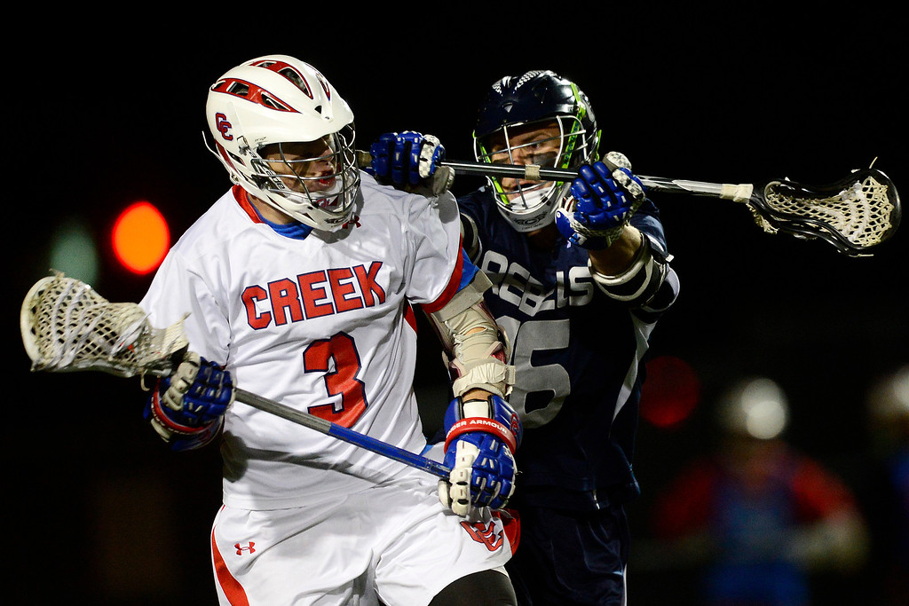 . Columbine\'s Tyler McMinimee defends Cherry Creek\'s Grant Bolling during Cherry Creek\'s 7-6 win.  (Photo by AAron Ontiveroz/The Denver Post)