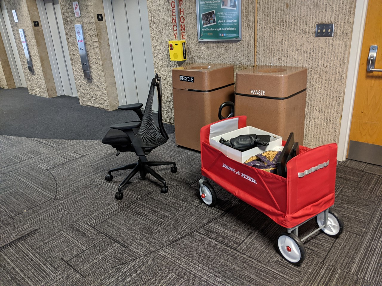 Desk chair and wagon, headed for the elevator in Dunbar Library, March 20, 2020