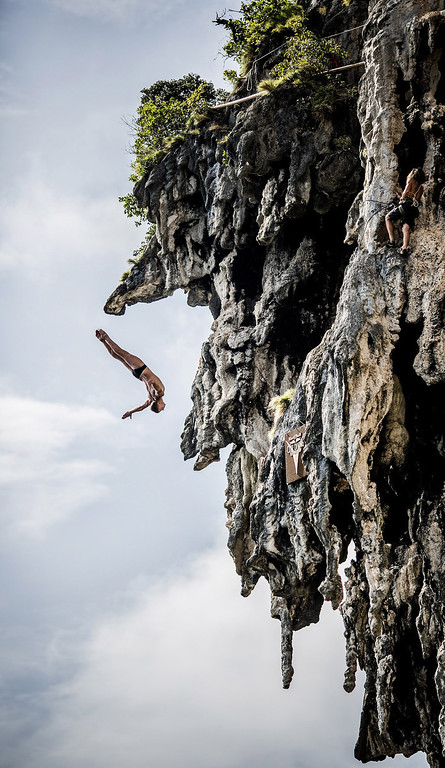 . In this handout image provided by Red Bull, Artem Silchenko of Russia dives from a 25 meter rock at Viking Caves in the Andaman Sea during competition on the fifth day of the final stop of the 2013 Red Bull Cliff Diving World Series on October 24, 2013 at Phi Phi Island, Thailand. (Photo by Romina Amato/Red Bull via Getty Images)