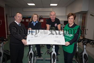 Gordon D'arcy and Cathy Larkin from Translink present a cheque to Karen Murdock from Macmillan for £1000 the proceeds of the successful 24 Hour Spinathon at St Paul's High School in 2015. Also pictured is Bill Geoghegan. This years Spinathon will be held on Tuesday 15th March at the school. R1606004