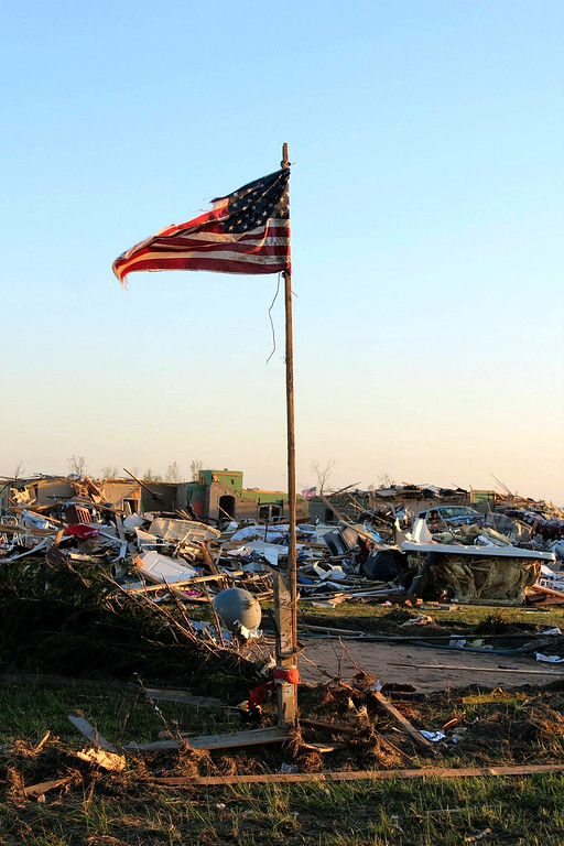 . In this handout provided by the Arkansas National Guard, an American flag stands amongst the rubble of a community following a deadly tornado April 28, 2014 in Vilonia, Arkansas.  (Photo by Arkansas National Guard via Getty Images)
