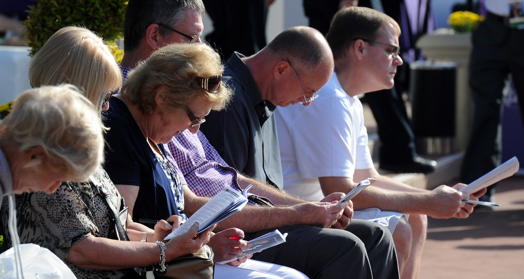 . Racing goers look over the program prior to the 2014 Breeders� Cup World Championships at Santa Anita Park in Arcadia, Calif., Friday, Oct. 31, 2014.  (Photo by Keith Birmingham/ Pasadena Star-News)