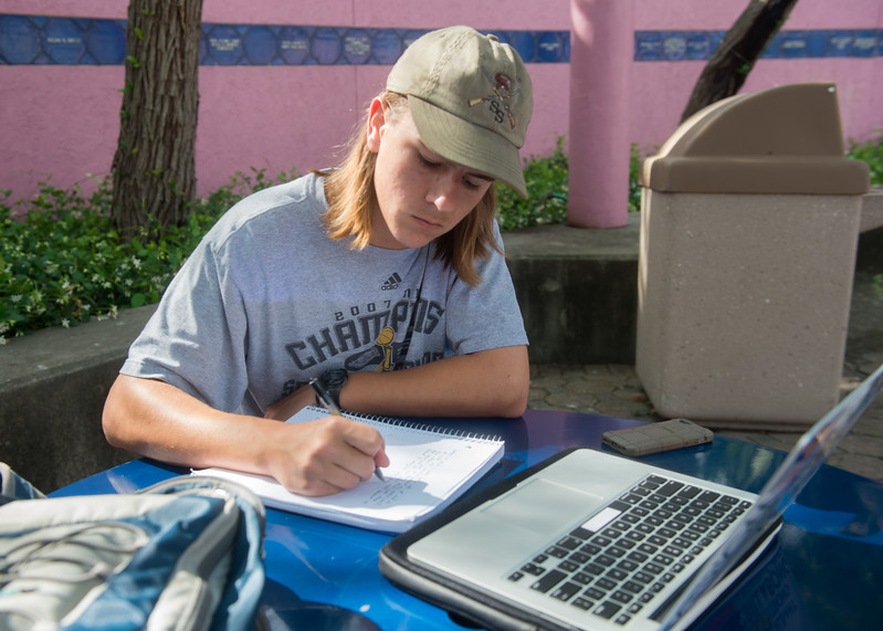 Student Chase Phillips finds an area to study in the Hector P. Garcia plaza.