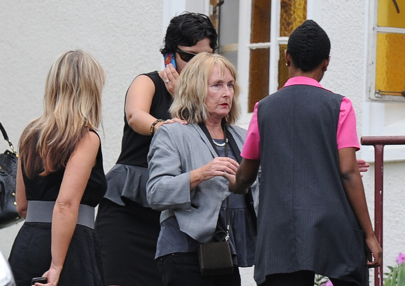 ". June Steenkamp, mother of the late South African model Reeva Steenkamp arrives at the crematorium building to attend her funeral ceremony in Port Elizabeth on February 19, 2013 after Steenkamp, 29, was shot four times in the early hours of February 14, 2013 by a 9mm pistol owned by South African sporting hero Oscar Pistorius. South African prosecutors on Tuesday told a bail hearing that Oscar Pistorius was guilty of ""premeditated murder\"" in the Valentine\'s Day killing of his model girlfriend at his upscale home.  ALEXANDER JOE/AFP/Getty Images"