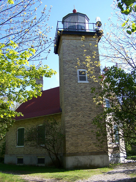 Eagle Lighthouse, Peninsula State Park. Since the lighthouse sits on top of a 40 foot bluff, it only needed to be 43 feet high to reach an adequate height above the water. It is constructed of Cream City Brick, manufactured in Milwaukee and known for its strength.