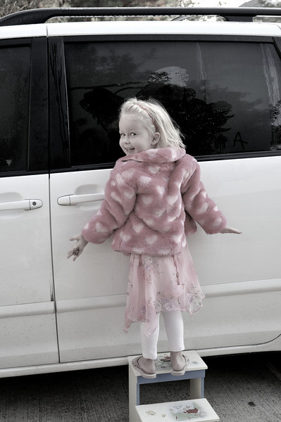 A summer dress, flip flops, and a winter coat, it is winter in Houston.