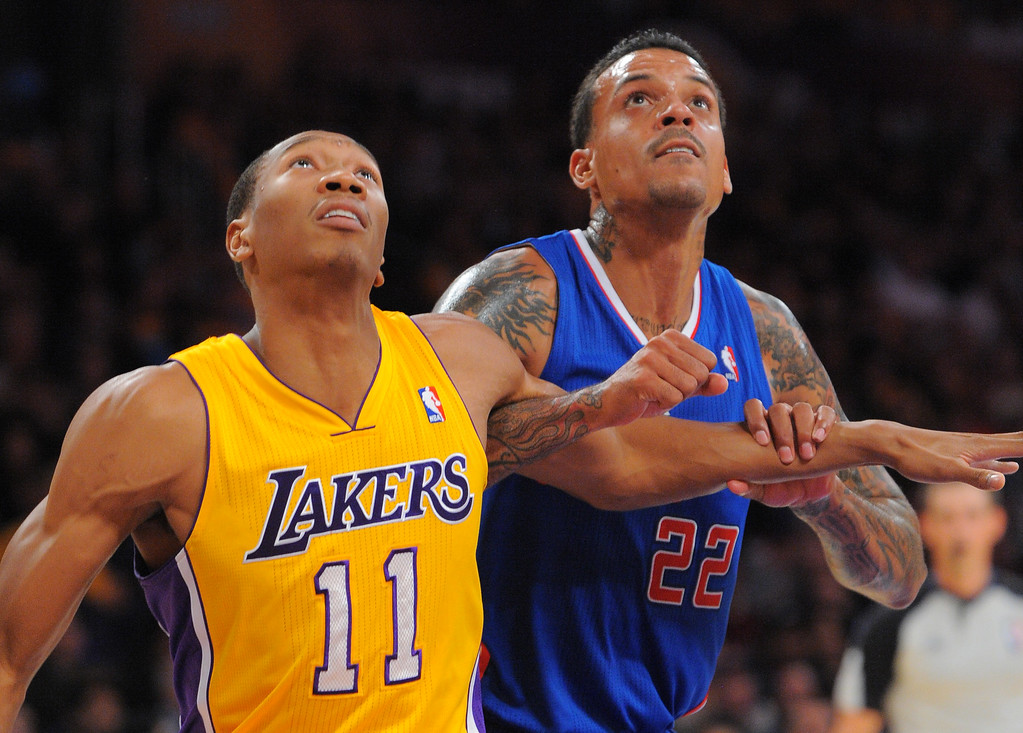 . Lakers Wesley Johnson, left, and Clippers Matt Barnes try to position themselves for a rebound in the NBA season opener between the Lakers and Clippers at Staples Center in Los Angeles, CA on Tuesday, October 29, 2013.  Lakers won 116-103. (Photo by Scott Varley, Daily Breeze)