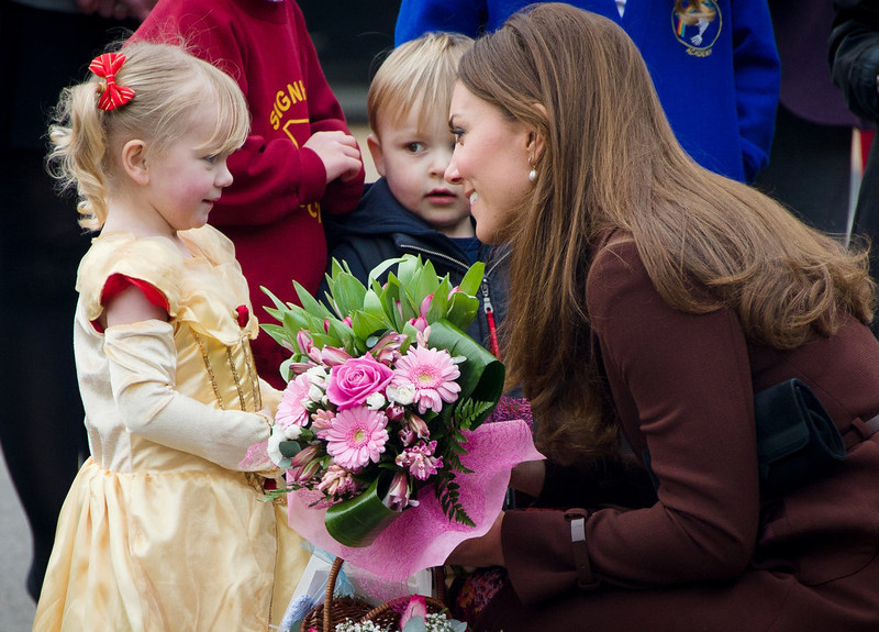 . Catherine, Duchess of Cambridge (R) meets three-year-old Isobelle Laursen during a visit to Peaks Lane fire station in Grimsby, northern England on March 5, 2013.  The Duchess of Cambridge is on an official visit to Grimsby during which she visited the National Fishing Heritage Centre and will meet with unemployed teenagers.  LEON NEAL/AFP/Getty Images