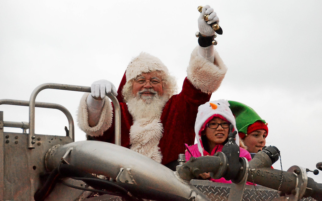 . Santa Claus and some of his elves ride in a Lorain fire engine during the 2016 Waterfront Winterfest Parade in downtown Lorain. The festivities mark the official start of the holiday season in the city. For more information, visit lorainwinterfest.com. (Morning Journal file)