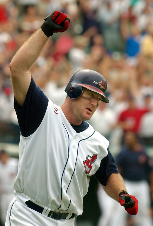 . Cleveland Indians slugger Jim Thome celebrates his ninth-inning grand slam to beat the Detroit Tigers 9-6   Sunday, July 28, 2002, in Cleveland. Thome\'s homer came off Detroit reliever Juan Acevedo. (AP Photo/Mark Duncan)