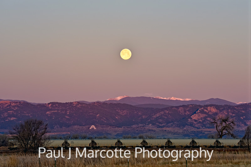 Full moon setting in Fort Collins