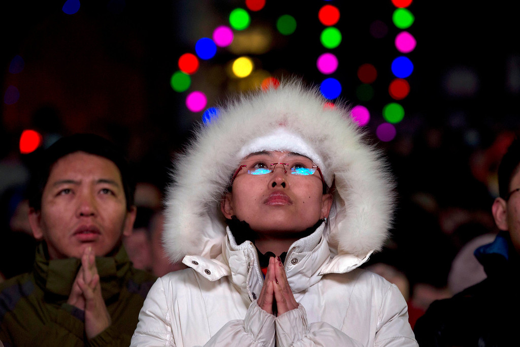 . Chinese catholics attend a Christmas Eve Mass service at the official Catholic church South Cathedral in Beijing, China, Tuesday, Dec. 24, 2013.  China and the Vatican have no diplomatic ties and the ruling Communist Party forced Chinese Catholics to sever their ties in the 1950s. China officially records about 6 million Catholics worshipping in 6,300 congregations across the country, although millions more are believed to worship outside the official church, with considerable crossover between the two in many areas.  (AP Photo/Ng Han Guan)