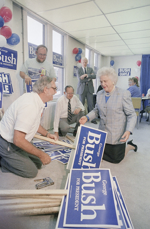 . Barbara Bush, wife of Vice President George Bush, helps Charles Schultz with campaign posters during  a stop at the Jefferson County Republican headquarters, Wednesday, Sept. 8, 1988 in Louisville, Ky. (AP Photo/Mike Fisher)