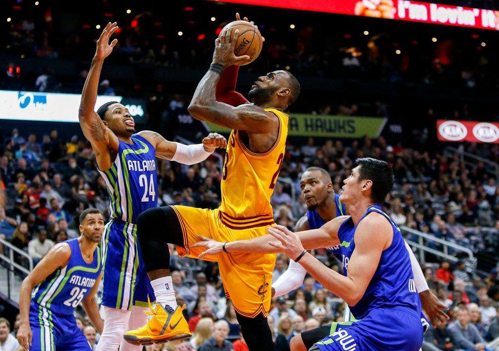 . Cleveland Cavaliers forward LeBron James (23) drives to the basket against the Atlanta Hawks in the second half of an NBA basketball game, Friday, March 3, 2017, in Atlanta. The Cavaliers won 135-130. (AP Photo/Brett Davis)