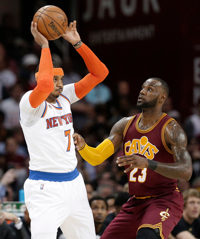 . New York Knicks\' Carmelo Anthony (7) looks to pass against Cleveland Cavaliers\' LeBron James (23) in the first half of an NBA basketball game, Thursday, Feb. 23, 2017, in Cleveland. (AP Photo/Tony Dejak)