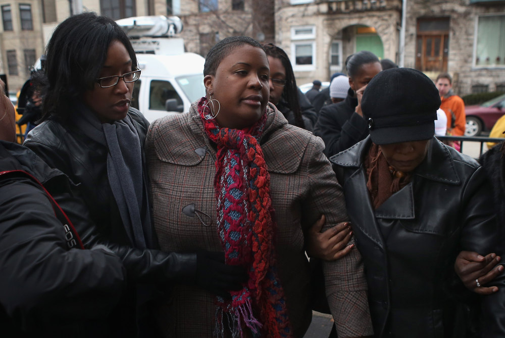. Cleopatra Cowley-Pendleton is comforted at a neighborhood park where her daughter Hadiya was killed on January 30, 2013 in Chicago, Illinois. Fifteen-year-old Hadiya was shot and killed when a gunman opened fire in the park yesterday while she was hanging out with friends on the warm rainy afternoon under a shelter in the park. Hadiya was a majorette in her high school band and recently performed in Washington, D.C. during the inauguration. President Obama\'s Chicago home is less than a mile from the park where Hadiya was killed.   Another person was wounded in the leg during the shooting.   (Photo by Scott Olson/Getty Images)