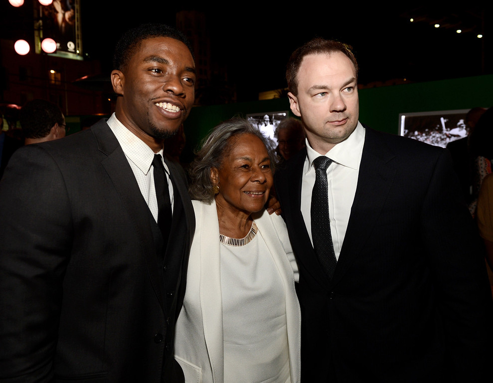 ". (L-R) Actor Chadwick Boseman, Jackie Robinson\'s widow Rachel Robinson and producer Thomas Tull pose at the after party for the premiere of Warner Bros. Pictures\' and Legendary Pictures\' ""42\"" at the Chinese Theatre on April 9, 2013 in Los Angeles, California.  (Photo by Kevin Winter/Getty Images)"