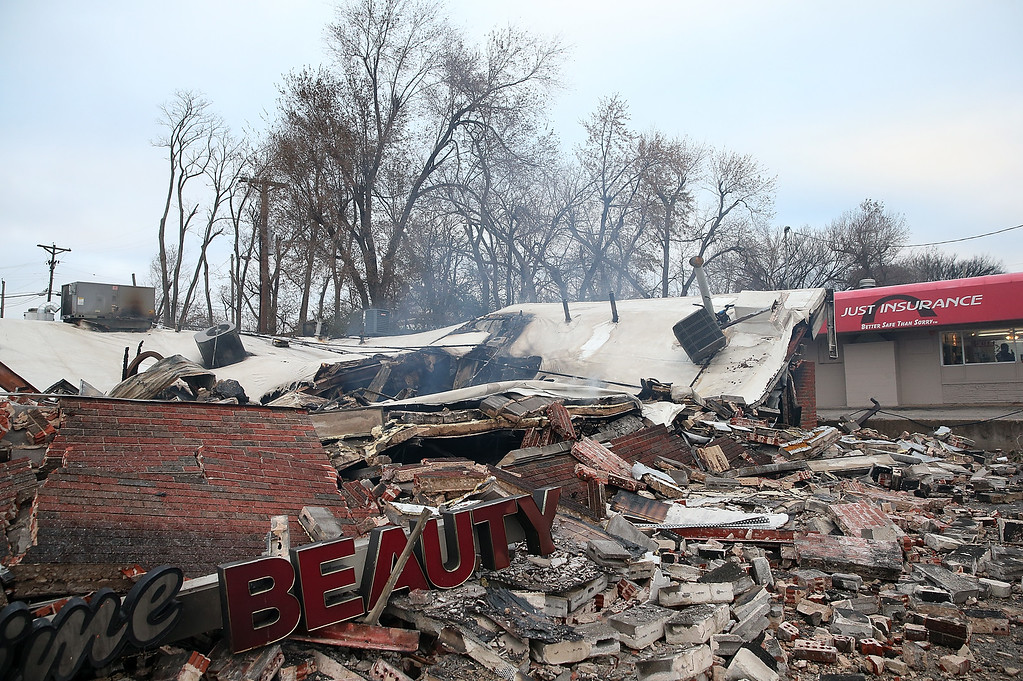 . A sign sits amidst rubble at a building that was damaged during a demonstration on November 25, 2014 in Dellwood, Missouri.  Demonstrators caused extensive damage in Ferguson and surrounding areas after a St. Louis County grand jury decided to not indict Ferguson police Officer Darren Wilson in the shooting of Michael Brown.  (Photo by Justin Sullivan/Getty Images)