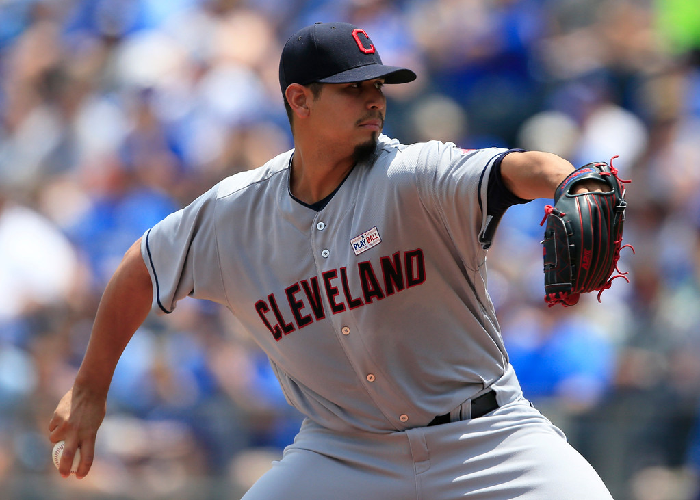 . Cleveland Indians starting pitcher Carlos Carrasco delivers to a Kansas City Royals batter during the first inning of a baseball game at Kauffman Stadium in Kansas City, Mo., Saturday, June 3, 2017. (AP Photo/Orlin Wagner)