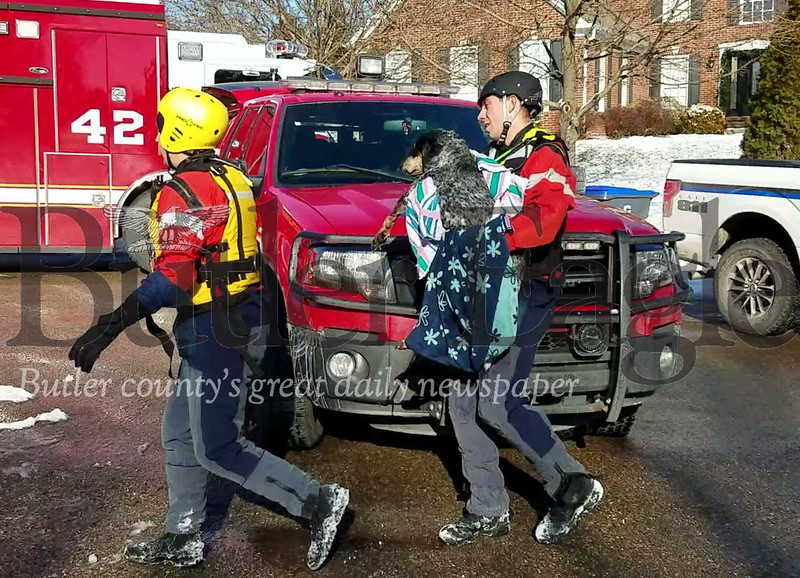 """First responders from Cranberry, Adams and Middlesex townships assisted in the water rescue of a dog Thursday afternoon. The dog was retrieved from a frozen pond near Deep Lake Drive, where it was in frigid water for an estimated 30 minutes."" Photo by Samantha Beal."