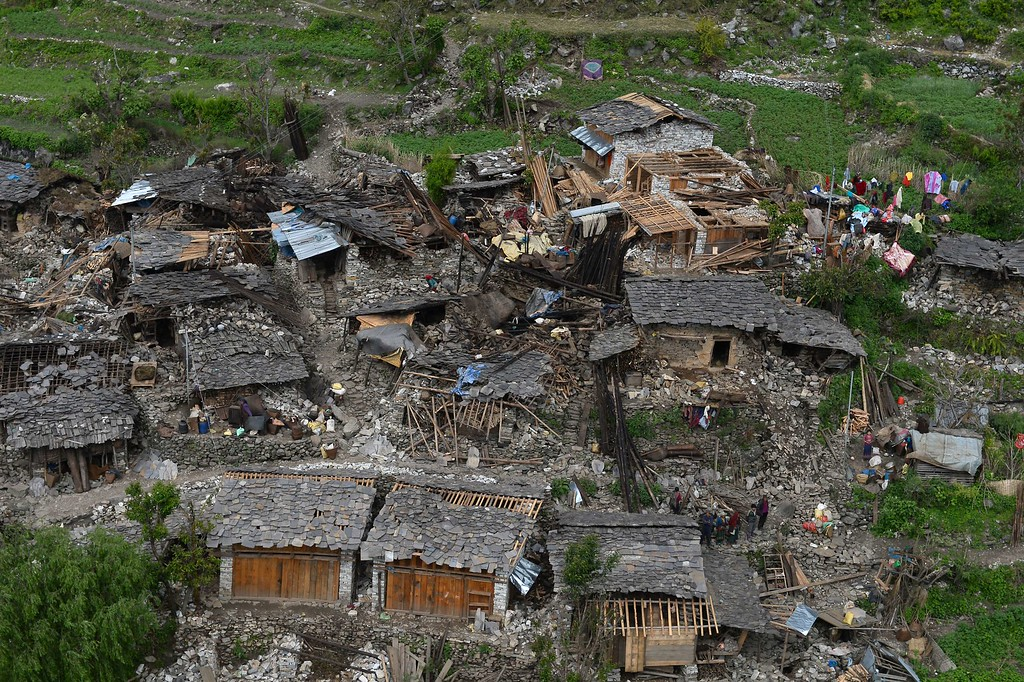 . Damaged houses are pictured from an Indian Army helicopter at Kerauja village, in northern-central Gorkha district on April 29, 2015.   Hungry and desperate villagers rushed towards relief helicopters in remote areas of Nepal, begging to be airlifted to safety, four days after a monster earthquake killed more than 5,000 people.    AFP PHOTO / SAJJAD  HUSSAIN/AFP/Getty Images