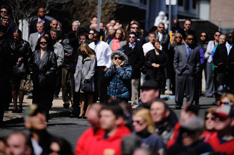 . Mourners react as a hearse arrives at St. Joseph Catholic Church for the funeral of Krystle Campbell, a victim of the Boston Marathon bombing, on April 22, 2013 in Medford, Massachusetts. A manhunt ended for Dzhokhar A. Tsarnaev, 19, a suspect in the Boston Marathon bombing after he was apprehended on a boat parked on a residential property in Watertown, Massachusetts. His brother Tamerlan Tsarnaev, 26, the other suspect, was shot and killed after a car chase and shootout with police. The bombing, on April 15 at the finish line of the marathon, killed three people and wounded at least 170.  (Photo by Kevork Djansezian/Getty Images)