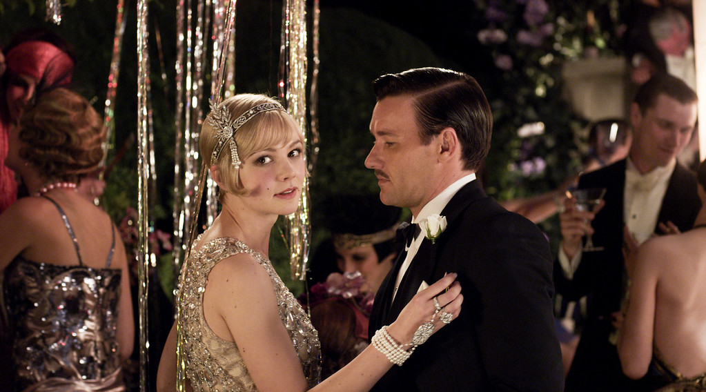 """. (L-r) CAREY MULLIGAN as Daisy Buchanan and JOEL EDGERTON as Tom Buchanan in Warner Bros. Pictures and Village Roadshow Pictures� drama � \""""THE GREAT GATSBY,\"""" a Warner Bros. Pictures release."""